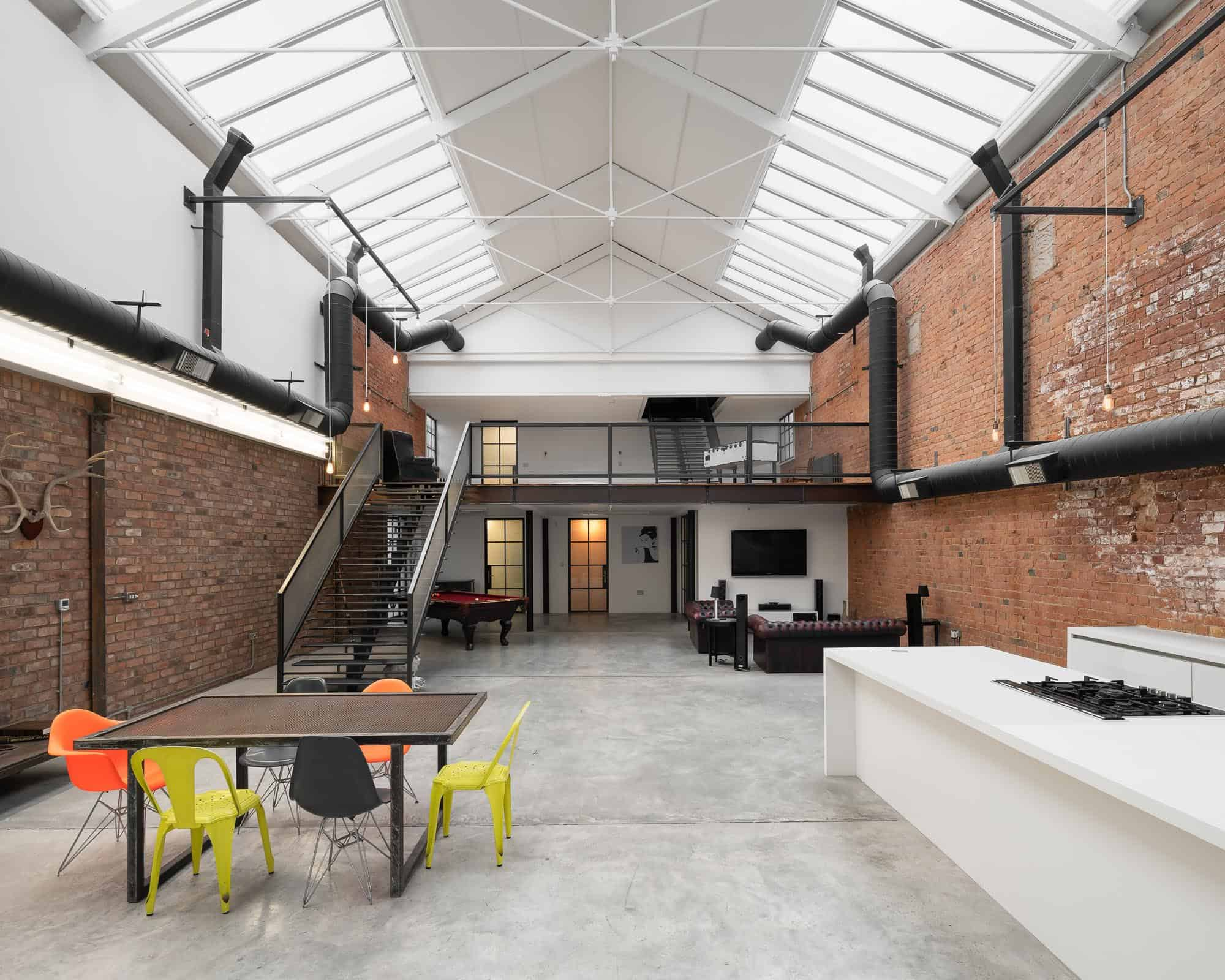 Bedford Loft CV32 - A converted warehouse in Leamington Spa. Concrete floors, exposed brick walls, and flooded with natural light - The Location Guys